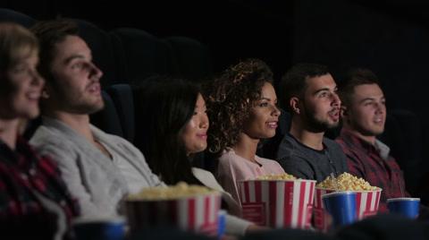 friends-cinema-watching-movie-footage-056234376_iconl